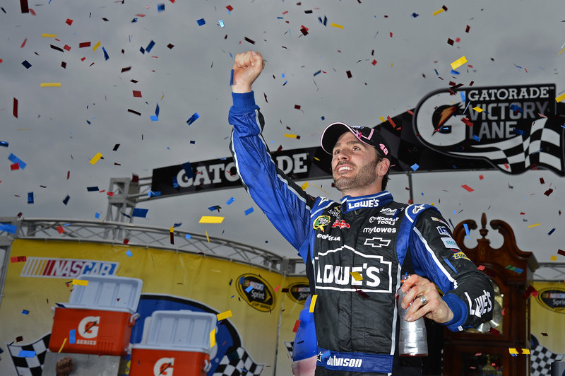 Jimmie Johnson celebrates after winning Sunday's Sprint Cup race at Martinsville Speedway. With three races left, Johnson is in line for his sixth championship.