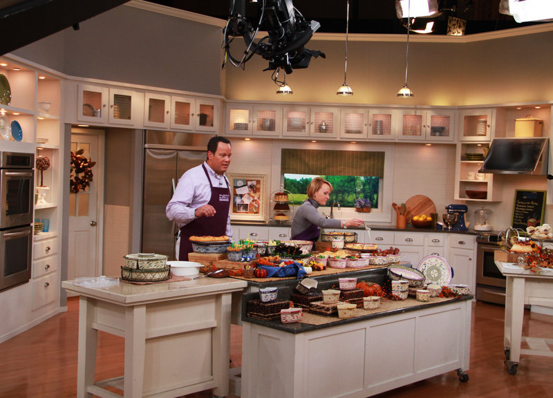 "QVC program host David Venable with Tara McConnell, above, on the set of ""In the Kitchen with David."""