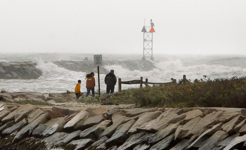 The remnants of superstorm Sandy were still kicking up substantial surf Tuesday, including at this jetty on Wells Beach.