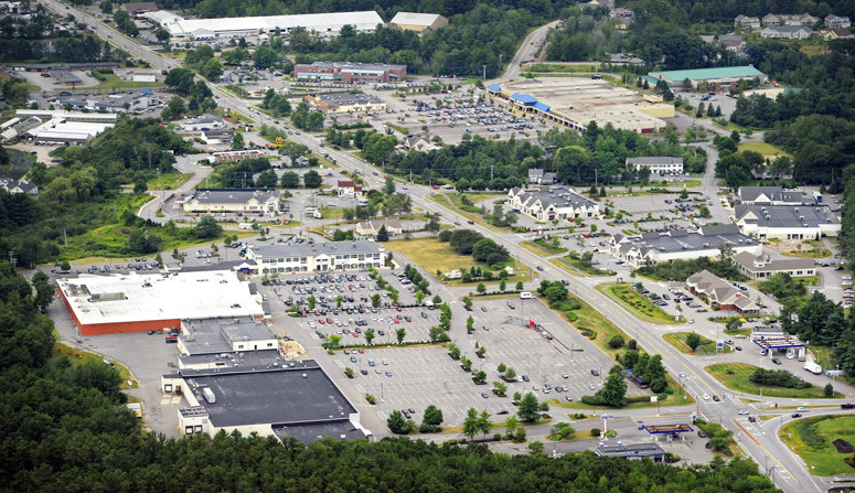 An aerial view of the Falmouth business district along Route 1. A new zoning law limits the size of ground-floor businesses in the retail zone between Bucknam Road and Route 88, which is currently home to a Walmart, a Shaw's supermarket, and a massive shopping complex that is dotted by vacancies.