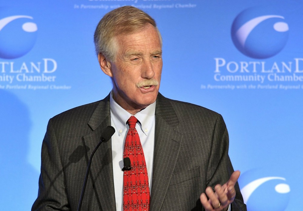 Gordon Chibroski / Staff Photographer: Charlie Hall, moderates as three of the candidates running for the Senate, Cynthia Dill, Angus King and Charlie Summers debate at Eggs and Issues at the Holiday Inn by the Bay in Portland on Tuesday, October 9, 2012. Here, Angus King responds to a question.