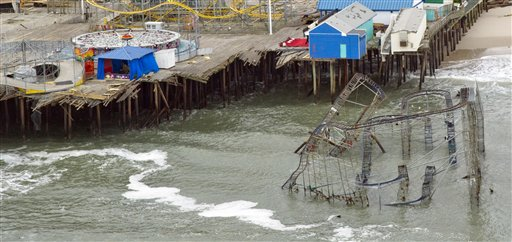 This Thursday, Nov. 1, 2012 aerial photo shows damage to the Casino Pier amusement park in Seaside Heights, N.J. caused by Superstorm Sandy, where part of the pier and a roller coaster fell into the ocean. (AP Photo/The Philadelphia Inquirer, Clem Murray) MAGS OUT, NEWARK OUT 304d43545934464c;696e717763