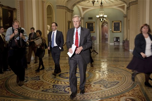 Senator-elect Angus King, I-Maine, walks to a news conference where he announced that he will caucus with the Democrats in the 113th Congress on Capitol Hill in Washington on Wednesday, Nov. 14, 2012.(AP Photo/Harry Hamburg)