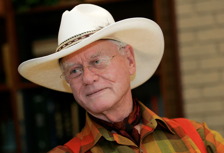 Actor Larry Hagman listens to a reporter's question in 2008 while visiting the Southfork Ranch in Parker, Texas, made famous in the television show