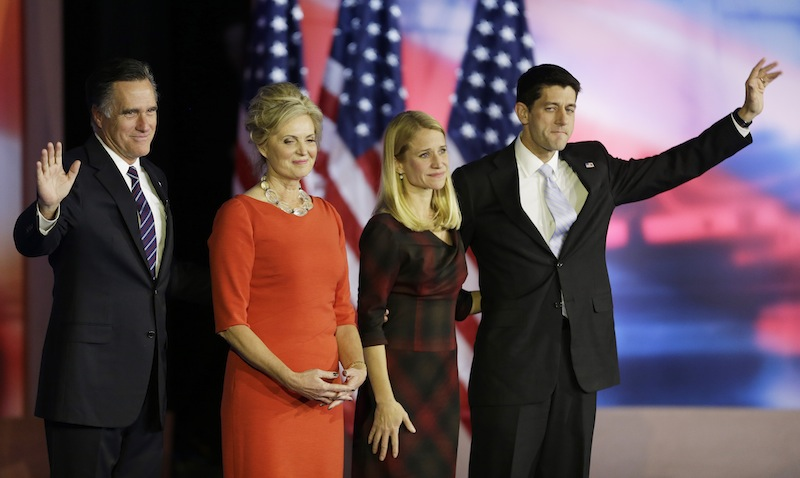 Republican presidential candidate and former Massachusetts Gov. Mitt Romney and his wife Ann stand on the stage with Republican vice presidential candidate, Rep. Paul Ryan, R-Wis., and his wife Janna after Mitt Romney conceded the race during his election night rally, Wednesday, Nov. 7, 2012, in Boston. (AP Photo/David Goldman)