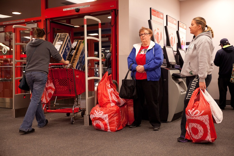 Shoppers make their way out of Target during their Black Friday sales event in Flint, Mich. on Thursday, Nov. 22, 2012. (AP Photo/Flint Journal, Griffin Moores)