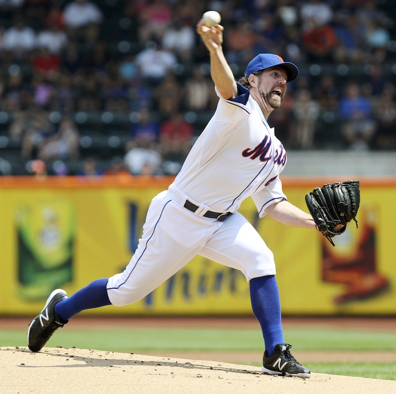 This Aug. 9, 2012 file photo shows New York Mets' R.A. Dickey pitching during the first inning of a baseball game against the Miami Marlins at Citi Field in New York. Dickey is a favorite to take home the AL Cy Young Award, Wednesday, Nov. 14, 2012. (AP Photo/Seth Wenig, FIle)