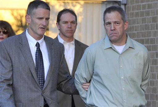 JetBlue pilot Clayton Frederick Osbon, right, is escorted to a waiting vehicle by FBI agents as he is released from The Pavilion at Northwest Texas Hospital, in Amarillo, Texas, in this In this April 2, 2012, photo. Osbon was charged with interference with a flight crew for his behavior on the March 27 flight from New York to Las Vegas.