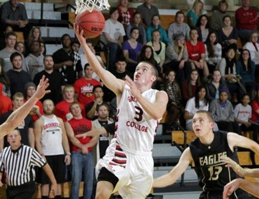 This image provided by Grinnell College shows guard Jack Taylor shooting one of 108 shots during Tuesday's game against Faith Baptist Bible in Grinnell, Iowa.