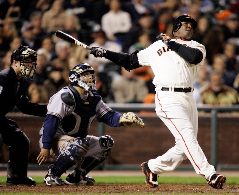 In this Aug. 24, 2007, file photo, San Francisco Giants' Barry Bonds, right, hits his 761st career home run, a solo effort, off Milwaukee Brewers pitcher Chris Capuano in the fourth inning of a baseball game in San Francisco. Bonds, Roger Clemens and Sammy Sosa are set to show up on the Hall of Fame ballot for the first time on Wednesday, Nov. 28, 2012, and fans will soon find out whether drug allegations block the former stars from reaching baseball's shrine. (AP Photo/Marcio Jose Sanchez, File)