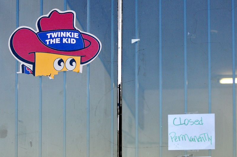 The head of Twinkie The Kid poster remains on the Wonder Hostess Bakery Outlet store in Victorville, Calif, where a posted sign displays