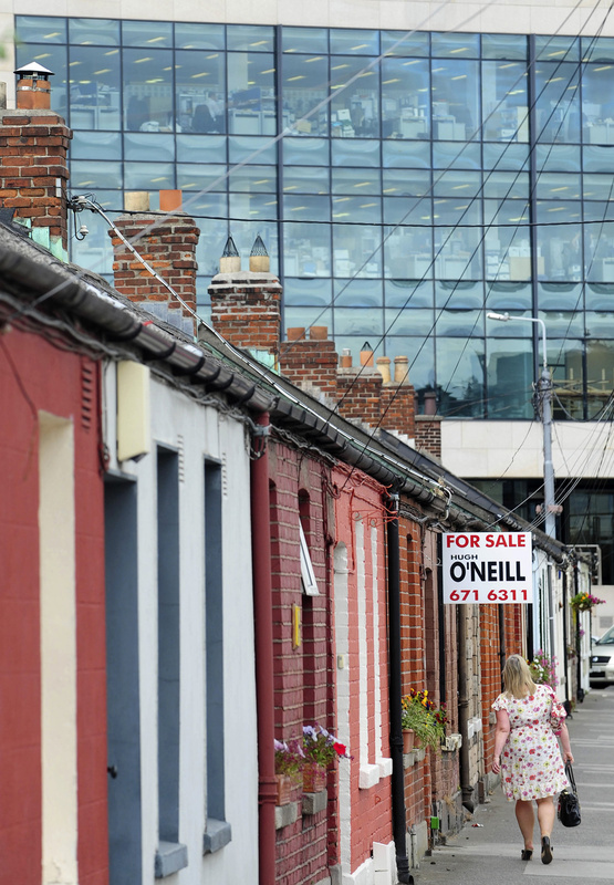 "A row of cottages in Dublin in 2011. ""I'm not calling any massive recovery, but people are going to look back and see a lot of missed opportunities in Ireland if they had the cash,"" says the head of one property broker."