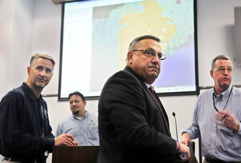 Staff photo by Andy Molloy STORM TOUR: Gov. Paul LePage tours the Maine Emergency Management Agency in Augusta on Monday.