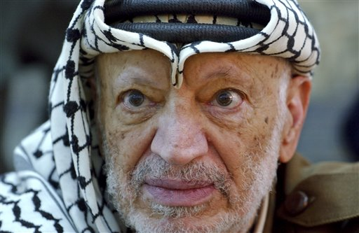 Palestinian leader Yasser Arafat in an October 2004 photo. He died in November 2004 at a French military hospital, a month after suddenly falling ill at his Ramallah compound, which was at the time besieged by Israeli troops.