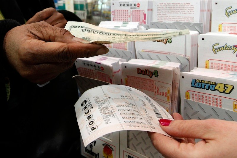 Donna Fields pays for her Powerball tickets in Detroit, Wednesday, Nov. 28, 2012. Fields picked two sets of numbers off the top of her head and two easy picks in tonight's Powerball total with an estimated $550 million jackpot. Fields said,