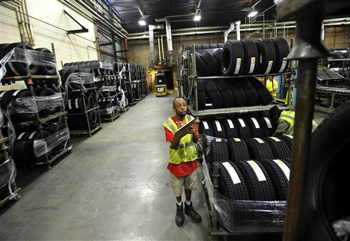 Forklift driver Clyde Boyce takes inventory recently in the warehouse at a Michelin tire manufacturing plant in Greenville, S.C. The U.S. grew at a rapid 2.7 percent in the third quarter, but Hurricane Sandy and uncertainty has likely dampened growth during the fourth quarter.