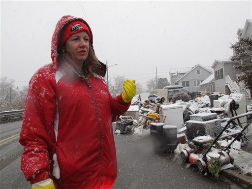 Laura DiPasquale talks about spending a third straight day looking through trash bags holding the contents of her storm-ruined house in Point Pleasant Beach, N.J., on Wednesday.
