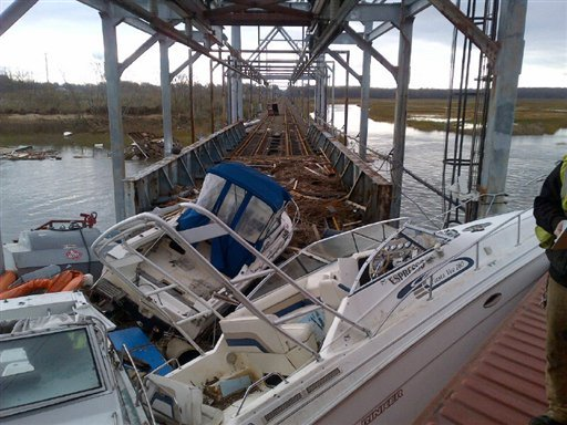 This undated photo made available by New Jersey Transit shows boats and other debris on New Jersey Transit's Morgan draw bridge in the aftermath of superstorm Sandy, in South Amboy, N.J.