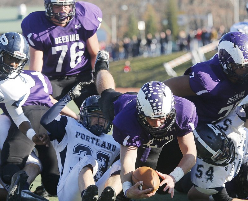Ken Sweet of Deering dives to score during the first quarter in the Thanksgiving Day football game with Portland High School.