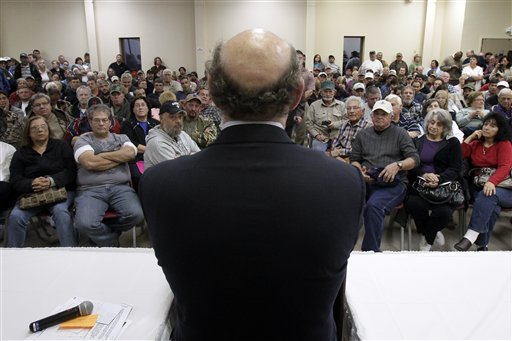 FILE - In this Jan. 10, 2011 photo, claimants listen to BP oil spill fund administrator Kenneth Feinberg, center, as he speaks at a town hall meeting in Grand Isle, La. In court filings late Monday, Oct. 22, 2012, the oil giant BP asked a federal judge to disregard objections from a fraction of claimants and give final approval to a proposed multibillion-dollar settlement for economic damages from the Gulf spill. (AP Photo/Patrick Semansky, File)