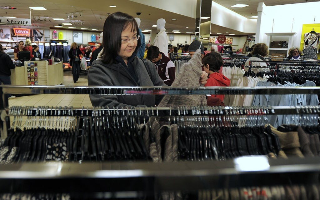 Cat Bibeau of South Portland browses through clothes at J.C. Penney at the Maine Mall on Friday morning. Black Friday shopping is a tradition for Bibeau, who started at midnight.
