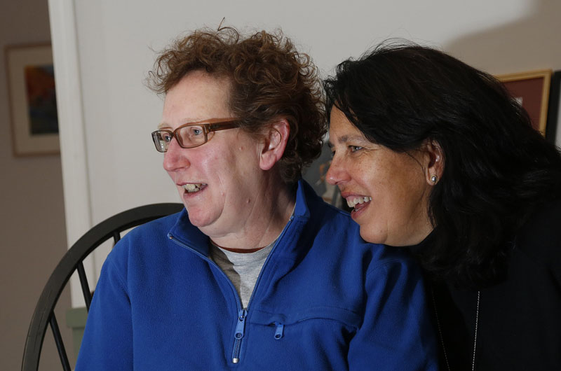 Norine Kotts, left, and Cheryl Lewis of Scarborough watch election results come in, Tuesday, Nov. 6, 2012, during a party at their house.