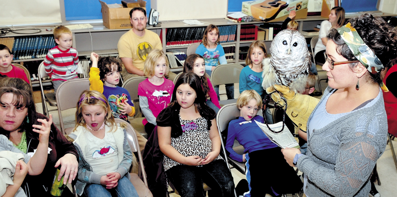 Kids at the Cornville Regional Charter School got to see live owls and bats during a Chewonki Foundation Traveling Natural History program on Thursday. Instructor Sarah Mortati shows and answers questions about the barred owl she held.