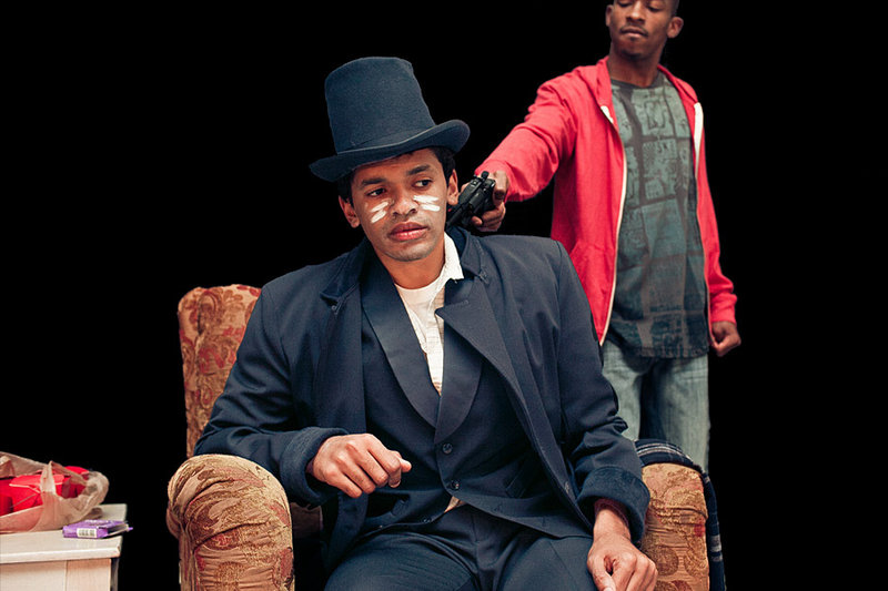 """Topdog/Underdog,"" the Pulitzer Prize-winning play by Suzan-Lori Parks presented by Dramatic Repertory Company and starring Bari Robinson, front, and J.H. Smith III, continues through Sunday at the Studio Theater at Portland Stage Company."