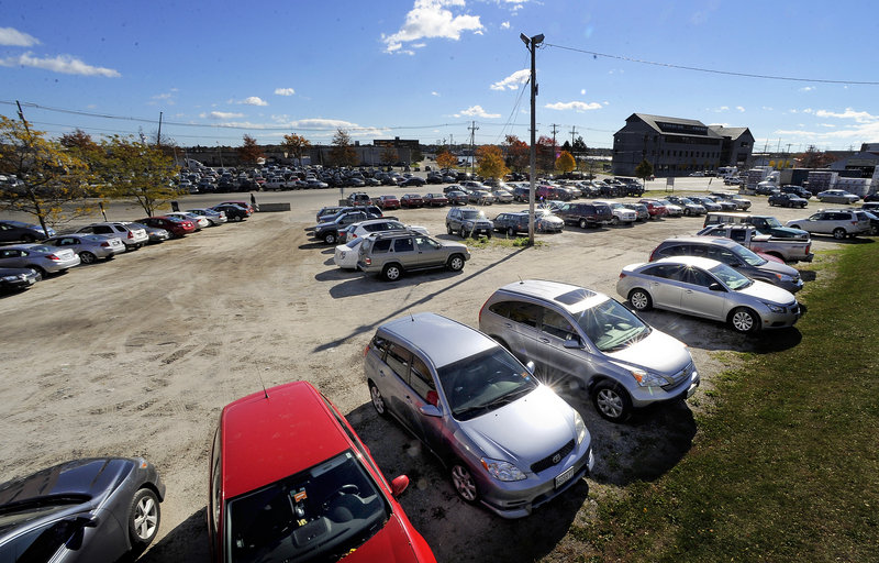 A Commercial Street parking lot at J.B. Brown & Sons is the proposed site of a 131-room Courtyard by Marriott that's expected to open sometime in 2014.