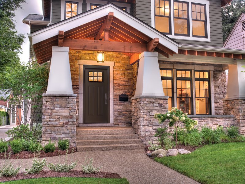 A Craftsman-style door from the Home Again by Hancock Lumber line provides a clean, elegant entry that adds to this home's exterior. The Therma-Tru door is made of fiberglass but looks like wood.