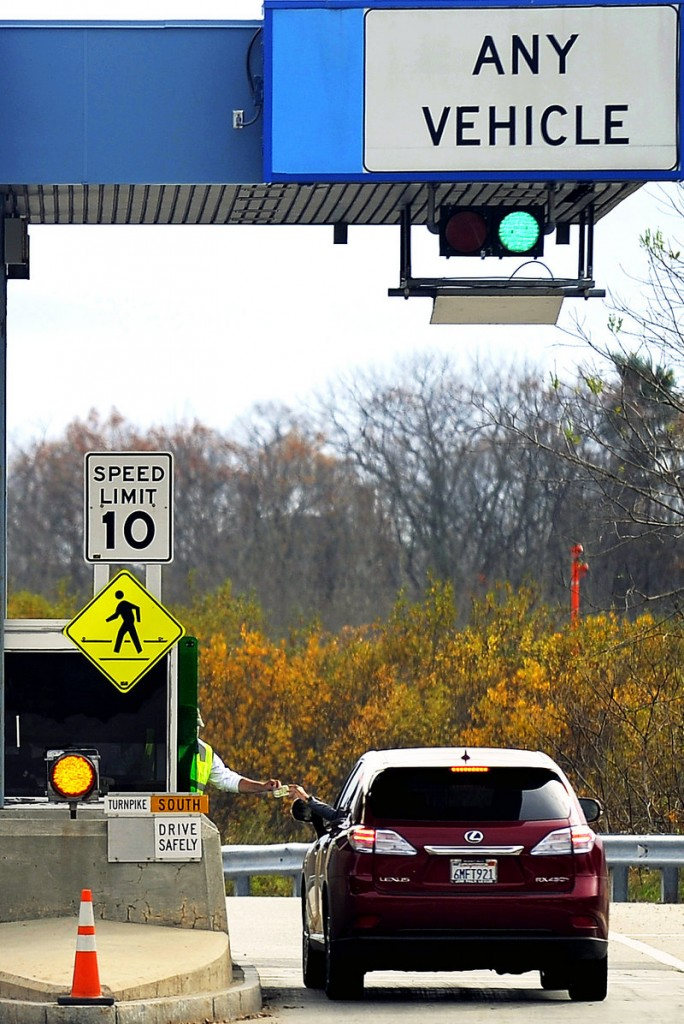 Paul Norton collects a toll at Exit 46 from a driver heading south on the turnpike Wednesday afternoon. Scheduled toll increases took effect at 12:01 a.m. Thursday.