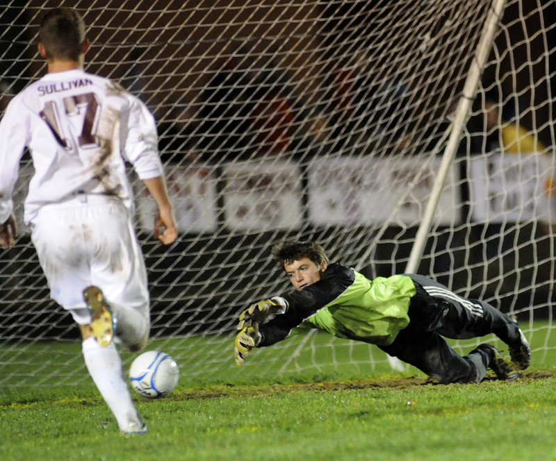 Gorham goalie Alex McCarthy dives to try to make a save, but a shot by Sam Cedaka of Scarborough eludes him for the only goal of the game Wednesday night in the Western Class A boys' soccer final at Gorham.