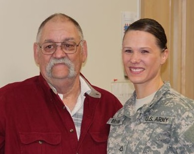 Larry Huff, 67, of Westbrook stands with Pfc. Lisa Bryant of Scarborough, a Maine Army National Guard medic who was honored Thursday for saving Huff's life after she saw his minivan crash on Interstate 295 in August.