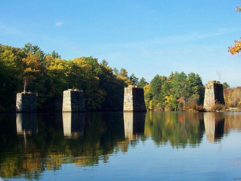 The old railroad bridge at Bar Mills caught the attention of Barbara Richards of Buxton as she paddled along the Saco River recently.