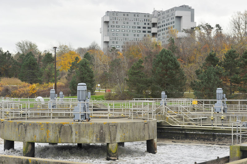 A condo building on the Eastern Prom overlooks Portland's wastewater treatment plant. Preliminary recommendations from sewage odor consultants for how to reduce bad smells from the plant will be presented to city residents next week.