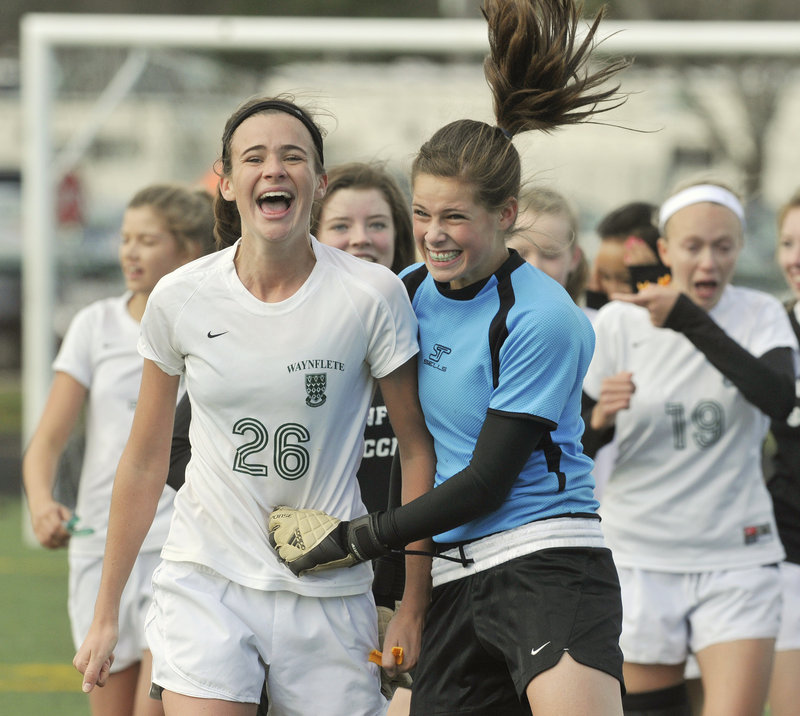 Believe it. It's true. Waynflete is the Class C girls' soccer state champion, and Sadie Cole, left, and keeper Jilianna Harwood couldn't hide their smiles.