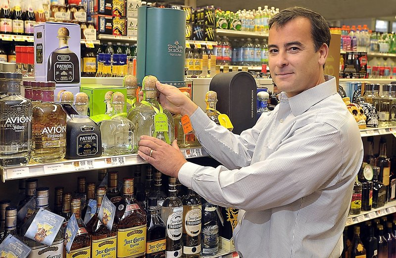 Adam Nappi, owner of Bow Street Market in Freeport, says retailers and resellers as a group support efforts to close the gap between prices in Maine and New Hampshire.