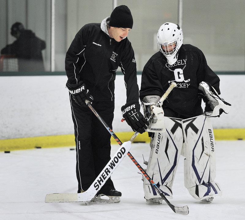 Greely Coach Nate Guerin instructs Maura Perry, a sophomore who'll take over as the Rangers' starting goalie after the graduation of Emma Seymour.