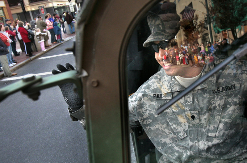 "Spc. San Pao, who served in Iraq with the Maine Army National Guard in 2004, waves from a humvee to spectators during the 2006 Veterans Day parade in Portland. ""All those men and women who will serve on the tip of the spear ... We owe them everything,"" a reader says."