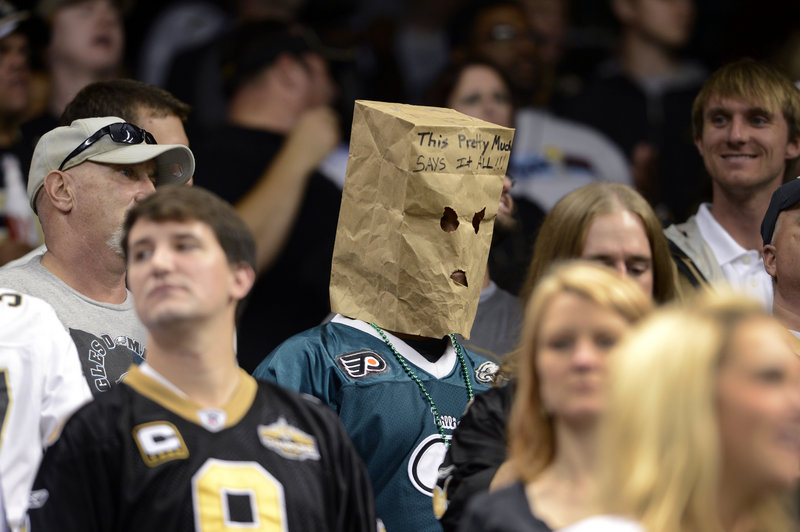 "A disgruntled Philadelphia Eagles fan wears a bag that says, ""This pretty much says it all"" at last week's game against New Orleans at New Orleans. The Saints beat the Eagles 28-13, and Philadelphia fell to 3-5 on the year."
