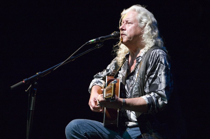 "Arlo Guthrie performs in a celebration of his father's music, ""Here Comes the Kid: Celebrating Woody Guthrie's 100th Birthday,"" on Wednesday at the Strand Theatre in Rockland."