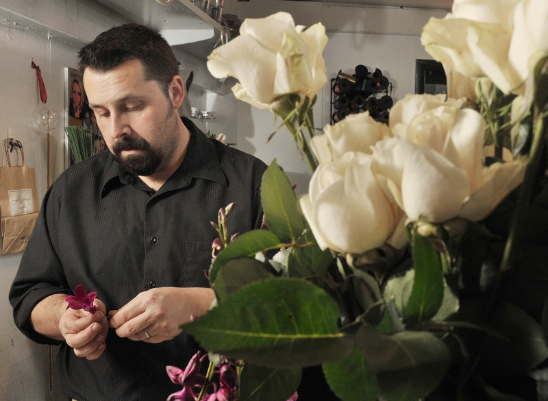 Jason Parent, a floral designer at Harmon's & Barton's flower shop in Portland, makes up boutonnieres and bouquets for an upcoming wedding. Maine's florists are among the businesses that expect to benefit from same-sex marriages being conducted in the state following passage of Question 1.