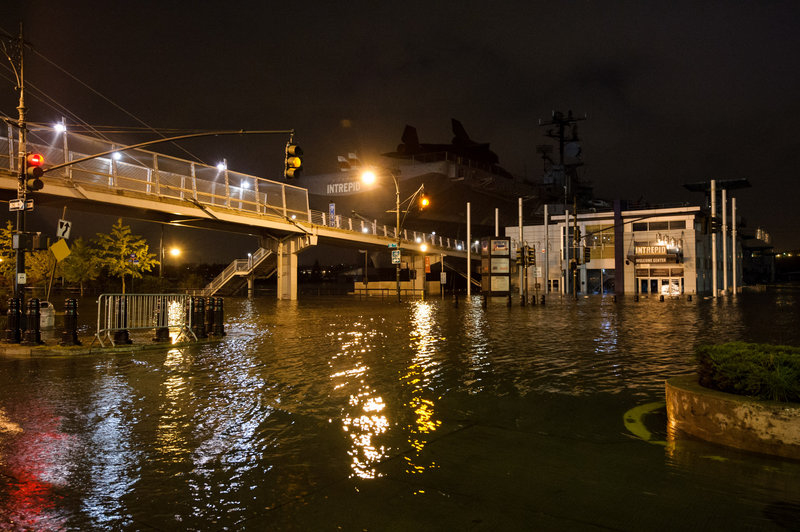 "Superstorm Sandy floods Manhattan's West Side Highway on Oct. 29. Both Sandy and last summer's ""extraordinary weather events"" should jump-start a national discussion on preventing climate change, a reader says."