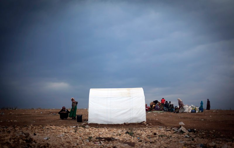 Families who fled violence in their villages take refuge in a camp in the Syrian village of Atmeh, near the Turkish border, on Thursday.