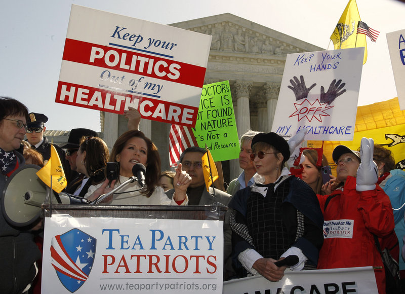U.S. Rep. Michele Bachmann, R-Minn., speaks outside the U.S. Supreme Court in Washington in March during the second day of arguments over the Affordable Care Act.