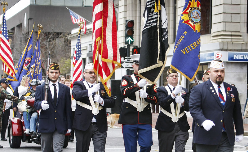 Members of Deering Memorial VFW Post 6859 color guard marches along Congress Street during the Portland Veterans Day parade Sunday. Homelessness among veterans is a growing problem in Portland and cities throughout America.