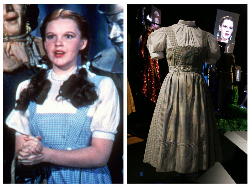 "Judy Garland portrays Dorothy in ""The Wizard of Oz."" At right is the dress she wore."