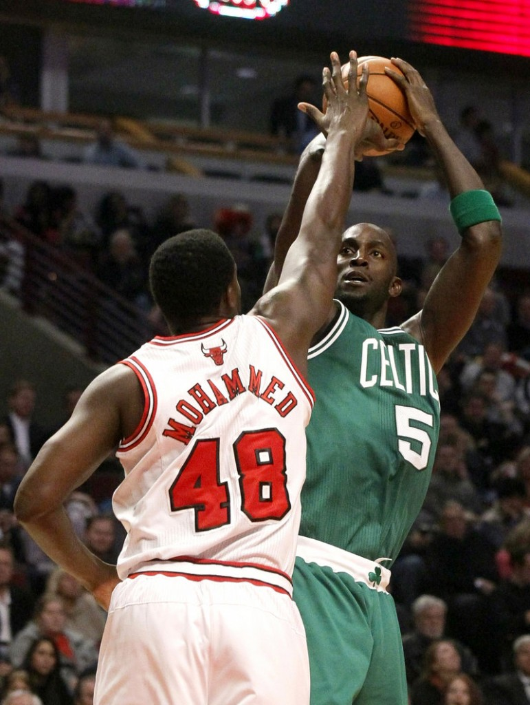 Kevin Garnett shoots over Nazr Mohammed of the Bulls during Monday's game in Chicago. Garnett scored 15 points for the Celtics, who climbed above the .500 mark for the first time this season.