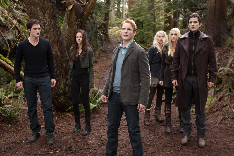"From left, Robert Pattinson, Kristen Stewart, Peter Facinelli, MyAnna Buring, Casey LaBow and Christian Camargo in a scene from ""The Twilight Saga: Breaking Dawn – Part 2."""