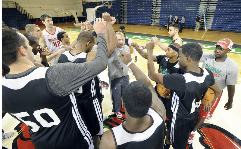 Mike Taylor, coach of the Maine Red Claws, brings his team together Tuesday during media day at the Portland Expo. The team started camp Monday and will open its NBA D-League schedule Friday, Nov. 23 at Canton. The home opener is Nov. 30 against Los Angeles.
